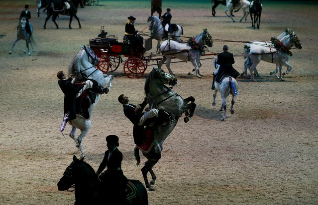 Riders perform during the opening show of the Sicab International Pre Horse Fair which is dedicated in full and exclusively to the purebred Spanish horse in the Andalusian capital of Seville, southern Spain, November 17, 2015. (Photo by Marcelo del Pozo/Reuters)