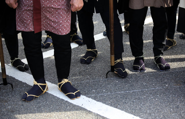 Members of a traditional firefighting preservation group wear straw sandals. during the annual New Year's Fire Brigade Review in Tokyo, Tuesday, January 6, 2015. (Photo by Eugene Hoshiko/AP Photo)