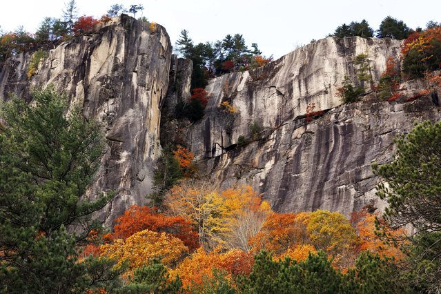 Fall colors are seen at New Hampshire's Cathedrel Ledge Monday, October 24, 2016, in Conway, N.H. (Photo by Jim Cole/AP Photo)