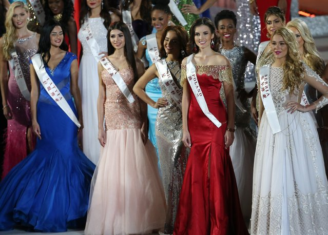 Miss Poland, Marta Kaja Palucka (2-R), Miss Serbia, Marija Cetkovic (R) and other contestants walk on stage during the grand final of the 65th Miss World pageant at the Beauty Crown Hotel Complex in Sanya, Hainan province, China, 19 December 2015. (Photo by How Hwee Young/EPA)