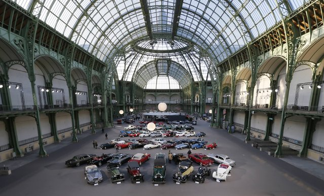 Vintage and classic cars are displayed ahead of the Bonhams' Les Grandes Marques du Monde vintage motor cars and motorcycles auction at the Grand Palais exhibition hall as part of the Retromobile vintage car show in Paris February 4, 2015. (Photo by Gonzalo Fuentes/Reuters)
