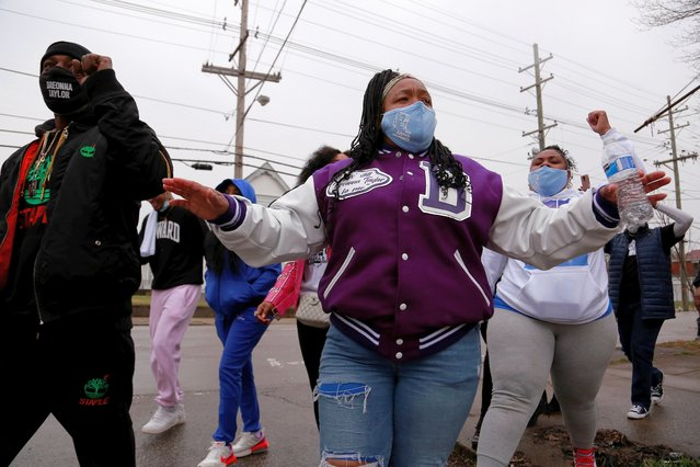 Tamika Palmer, her sister Halima Shaw, walk with volunteers chanting Breonna Taylor's name in the West End to distribute food to the neighbors, Louisville, Kentucky, U.S., March 14, 2021. (Photo by Amira Karaoud/Reuters)