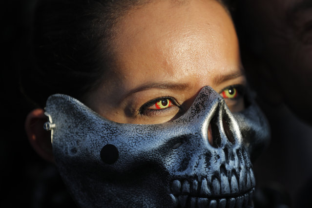 A dressed up Oakland Raiders fan poses for photos as she arrives at Azteca stadium in Mexico City, Monday, November 21, 2016. The Oakland Raiders face the Houston Texans at a sold out Azteca stadium. (Photo by Dario Lopez-Mills/AP Photo)