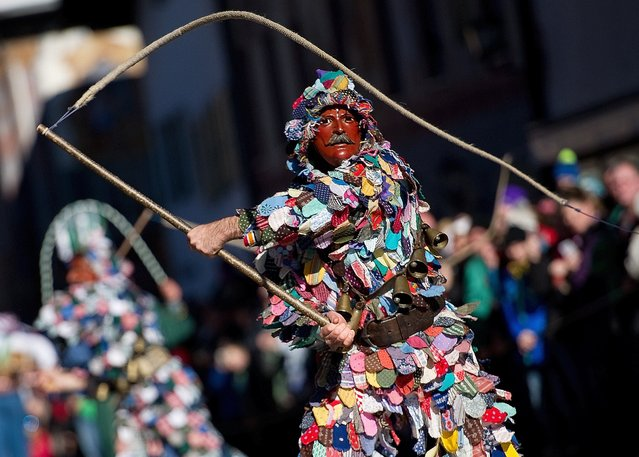 A costumed man is pictured during a carnival parade in Mittenwald, southern Germany on Febraury 12, 2015. (Photo by Angelika Warmuth/AFP Photo)