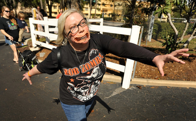 Zombie Walk participant Susan Harrington from St. Simons Island, Georgia gives her all during Zombie Walk, part of the day's Retr-O-Rama event in Jacksonville, Fla., Sunday, February 8, 2015 Comic book and vintage toy fans worked their way through the displays at Sunday's Retr-0-Rama Collectible Show as well as took part in a Zombie Walk outside the hotel and a costume contest inside. (Photo by Bob Self/AP Photo/The Florida Times-Union)