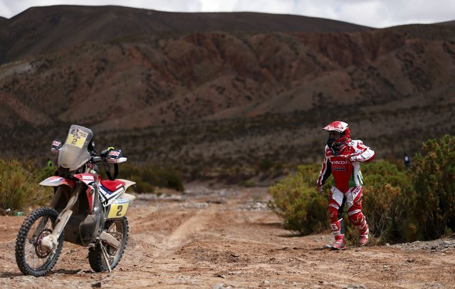 Paulo Goncalves of Portugal walks towards his Honda motorcycle at the end of the fourth stage in the Dakar Rally 2016 in Jujuy province, Argentina, January 6, 2016. (Photo by Marcos Brindicci/Reuters)