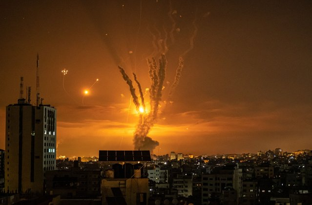 Rockets launched towards Israel from the northern Gaza Strip and response from the Israeli missile defense system known as the Iron Dome leave streaks through the sky on May 14, 2021 in Gaza City, Gaza. More than 65 people in Gaza and seven people in Israel have been killed in continued cross-border rocket exchanges as violence continues to escalate bringing fears of war. The escalation, which erupted May 10, comes after weeks of rising Israeli -Palestinian tension in East Jerusalem, which peaked with violent clashes inside the holy site of Al-Aqsa Mosque. (Photo by Fatima Shbair/Getty Images)