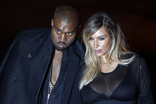 U.S. musician Kanye West (L) and companion Kim Kardashian arrive at the Givenchy Spring/Summer 2014 women's ready-to-wear fashion show during Paris Fashion Week September 29, 2013. (Photo by Charles Platiau/Reuters)