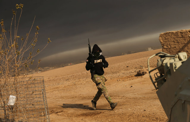 Iraqi forces backed by tribal militias during battle to retake a village from the Islamic State on the eastern bank of the river Tigris, Iraq December 7, 2016. (Photo by Mohammed Salem/Reuters)