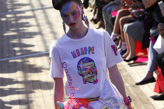 A model wears a creation printed with French soccer player Kylian Mbappe's face, for Manish Arora's Spring/Summer 2019 ready-to-wear fashion collection presented in Paris, Thursday, September 27, 2018. (Photo by Christophe Ena/AP Photo)