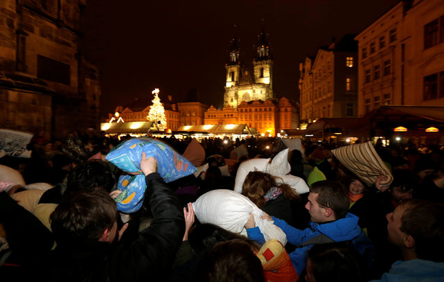 People take part in a four minute flash mob pillow fight at the Old Town Square in Prague, Czech Republic, December 22, 2016. (Photo by David W. Cerny/Reuters)