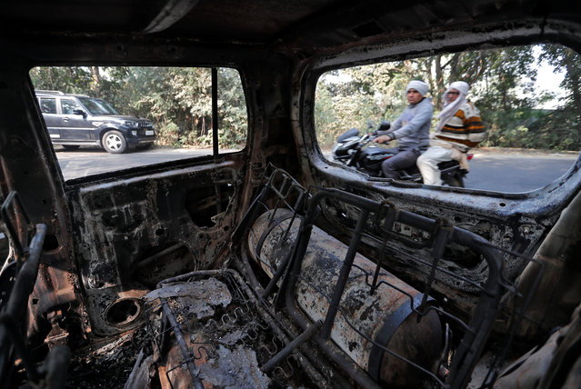 A charred vehicle is seen after it was burnt by a mob during a protest on Monday, in Chingrawti village in Bulandshahr district, Uttar Pradesh, December 5, 2018. (Photo by Adnan Abidi/Reuters)