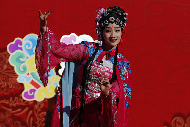 A Chinese performer dressed in traditional costume performs a cultural dance during a temple fair for a Lunar New Year celebration in Beijing, Monday, February 8, 2016. (Photo by Andy Wong/AP Photo)
