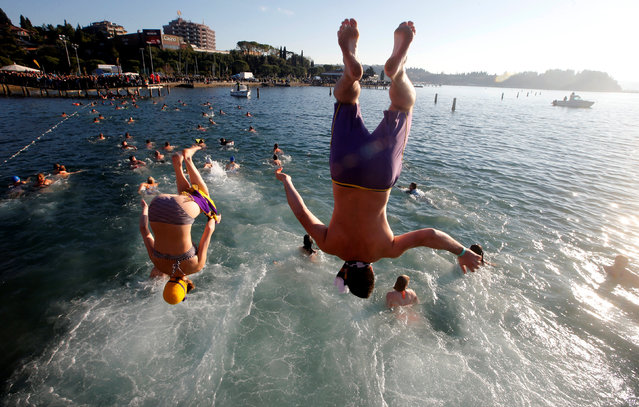 Revellers take part in New Year's Jump into the Sea in Portoroz, Slovenia January 1, 2017. (Photo by Srdjan Zivulovic/Reuters)