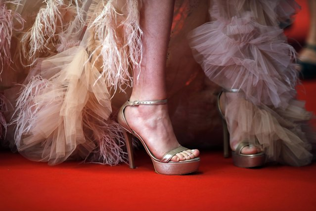 """A guest arrives for the screening of the film """"Bergman Island"""" at the 74th edition of the Cannes Film Festival in Cannes, southern France, on July 11, 2021. (Photo by Sarah Meyssonnier/Reuters)"""