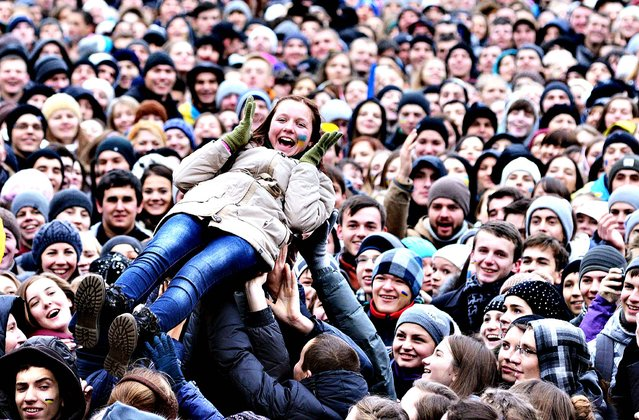 Students take part in a pro-European rally in the western Ukrainian city of Lviv on November 28, 2013. (Photo by Yuriy Dyachyshyn/AFP Photo)