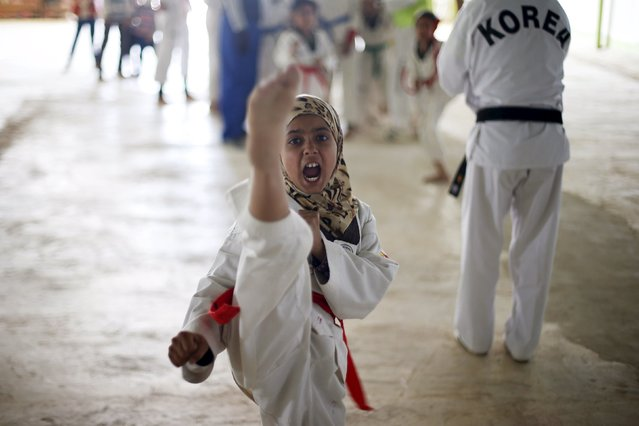 Syrian refugee girls undergo training in the Korean Taekwondo Academy For Syrian Children at the Al Zaatari refugee camp in the Jordanian city of Mafraq, near the border with Syria March 24, 2015. (Photo by Muhammad Hamed/Reuters)