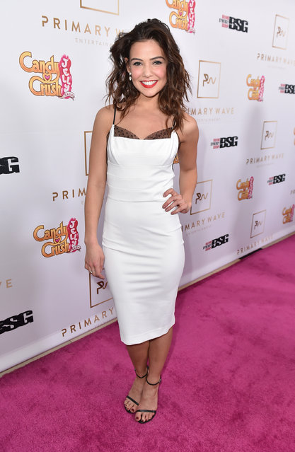 Danielle Campbell gives the Jelly Queen a run for her money on the pink carpet at the Candy Crush Jelly Saga – Primary Wave Pre-Grammy party at The London Hotel on Sunday, February 14, 2016, in Los Angeles. (Photo by Jordan Strauss/Invision for King Digital/AP Images)