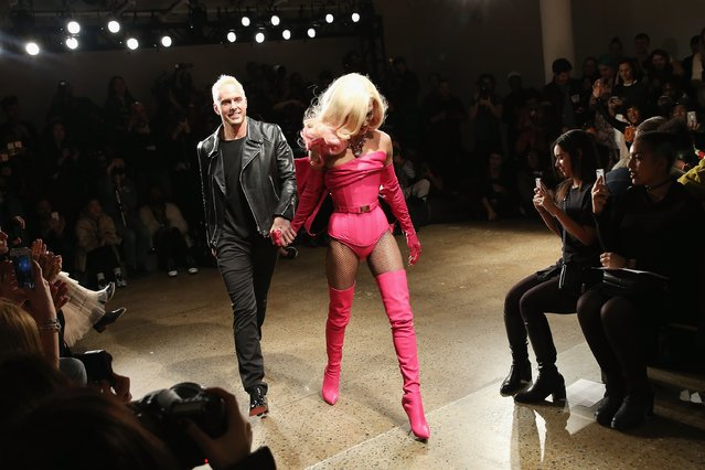 Designers David Blond (L) and Phillipe Blond walk the runway at The Blonds fashion show during Fall 2016 MADE Fashion Week at Milk Studios on February 17, 2016 in New York City. (Photo by Monica Schipper/Getty Images)