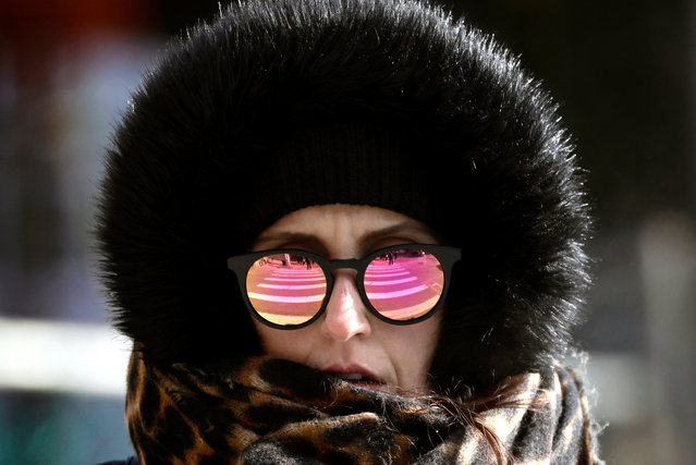 A pedestrian is bundled up as extremely cold weather blankets the Northeast region in New York, New York, USA, 21 January 2019. Temperatures today dipped to the lowest levels in almost three years in Central Park, with lows expected to reach 13 Fahrenheit (–10 Celsius). (Photo by Peter Foley/EPA/EFE)