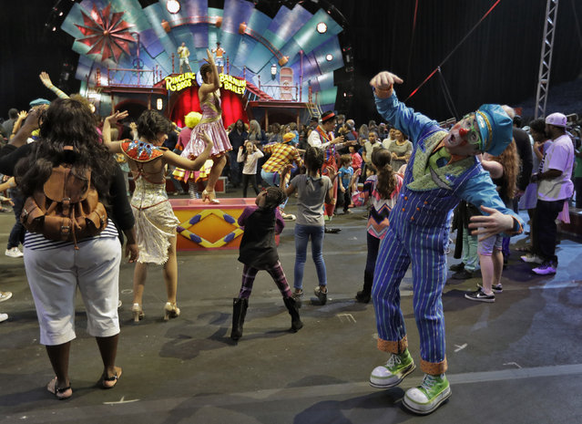 Ringling Bros. and Barnum & Bailey clowns dance with fans during a pre show for fans Saturday, January 14, 2017, in Orlando, Fla. (Photo by Chris O'Meara/AP Photo)