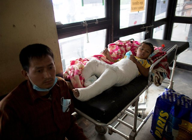 Seejan Tamang, a four-year-old, who was injured during Saturday's earthquake, lies on a gurney at a hospital in Kathmandu, Nepal, April 29, 2015. (Photo by Danish Siddiqui/Reuters)