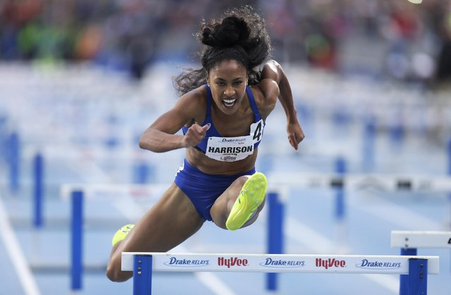 Queen Harrison clears a hurdle during the women's special shuttle hurdle relay at the Drake Relays athletics meet, Friday, April 24, 2015, in downtown Des Moines, Iowa. (Photo by Charlie Neibergall/AP Photo)