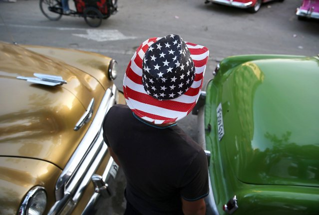 A man wears a hat with the colors of the US national flag in Havana, March 10, 2016. President Barack Obama is scheduled to visit Cuba on March 20, 2016. (Photo by Alejandro Ernesto/EPA)