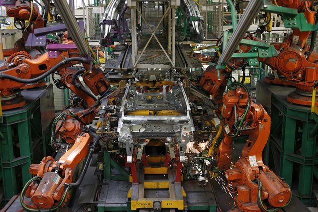 A view shows the automobile assembly line as robots work on the construction of Renault Clio IV at the Renault automobile factory in Flins, west of Paris, France, May 5, 2015. (Photo by Benoit Tessier/Reuters)