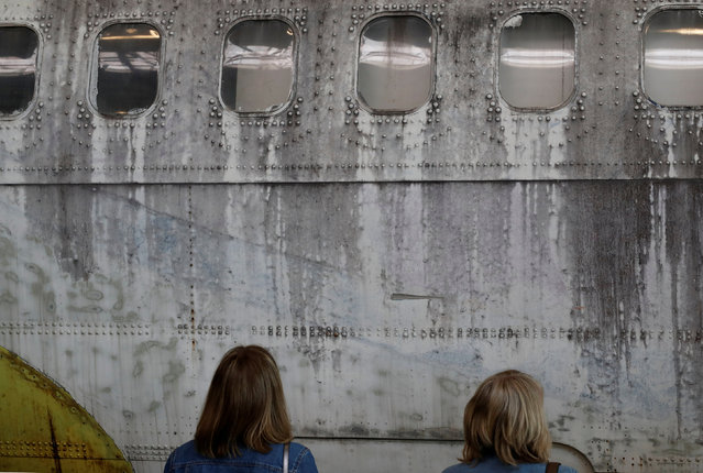 Visitors stand in front of the fuselage of a Boeing 737-200, also known as Landshut, at the Dornier Museum, an aviation museum in Friedrichshafen, Germany April 7, 2019. (Photo by Arnd Wiegmann/Reuters)