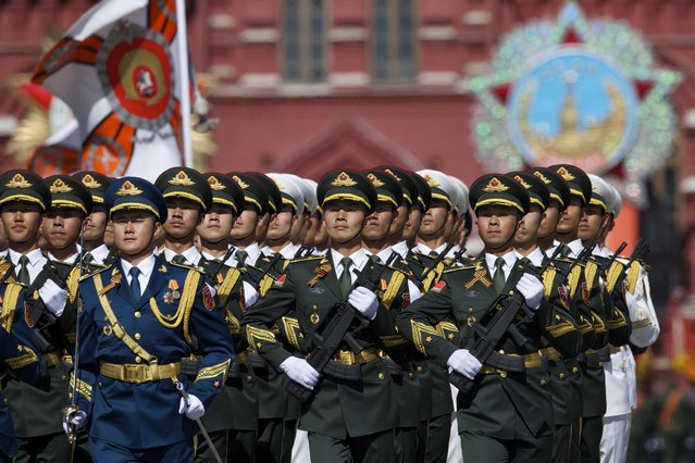 Chinese army soldiers march along the Red Square during a general rehearsal for the Victory Day military parade which will take place at Moscow's Red Square on May 9 to celebrate 70 years after the victory in WWII, in Moscow, Russia, Thursday, May 7, 2015. (Photo by Ivan Sekretarev/AP Photo)