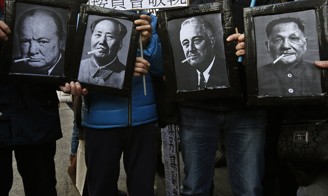 Protesters carry manipulated portraits of late political figures who were known smokers, (L-R) British Prime Minister Winston Churchill, Chinese leader Mao Zedong, U.S. President Franklin Roosevelt and Chinese leader Deng Xiaoping, against a potential tax increase on cigarettes to be announced during the upcoming annual budget in Hong Kong February 20, 2014. (Photo by Bobby Yip/Reuters)