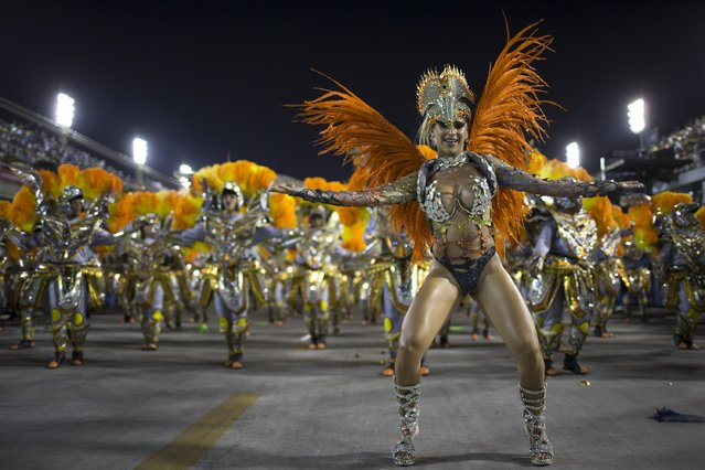 Performers from the Unidos da Tijuca samba school parade during carnival celebrations at the Sambadrome in Rio de Janeiro, Brazil, Tuesday, March 4, 2014. Brazil's Carnival is maintaining its frenetic pace, with hundreds of roving parties taking over Rio de Janeiro's streets and famed samba school parades heading into their final night. (Photo by Felipe Dana/AP Photo)
