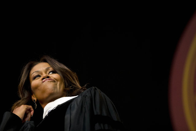 First lady Michelle Obama flips her hair after telling the graduates that they all look amazing just before delivering the commencement address at Tuskegee University, Saturday, May 9, 2015, in Tuskegee, Ala. (Photo by Brynn Anderson/AP Photo)