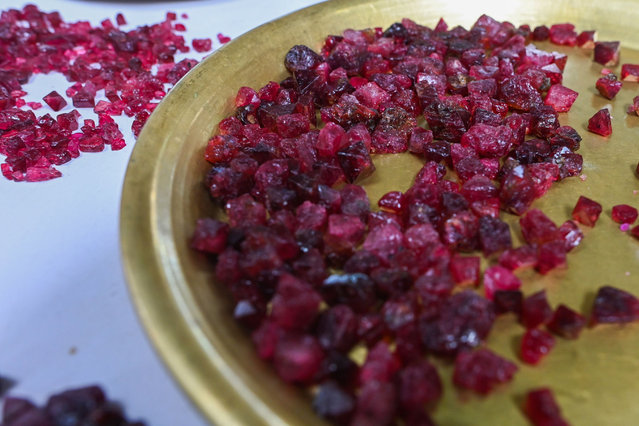 This photo taken on May 17, 2019 shows rough rubies displayed at the gems market in Mogok town, north of Mandalay. (Photo by Ye Aung Thu/AFP Photo)