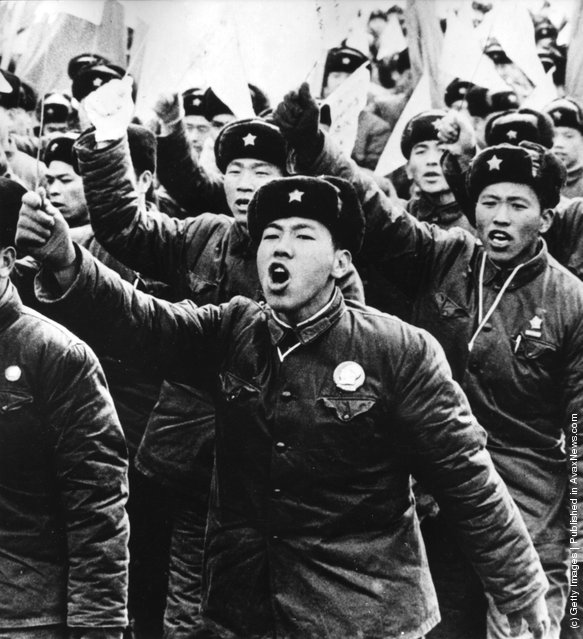1955: Chinese People's Liberation Army fighters demonstrating in Peking