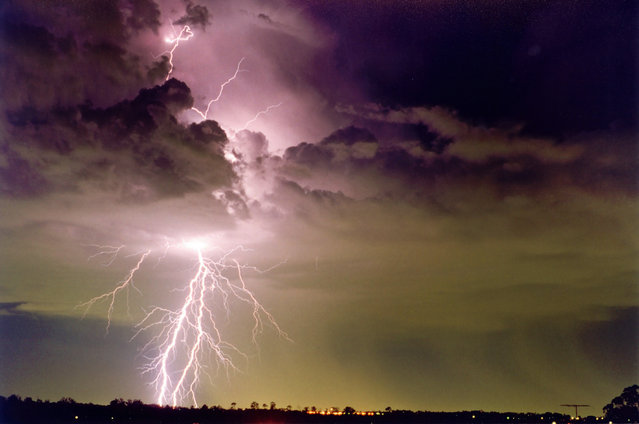 """Lightning Flash Photography"". Schofields, New South Wales, Australia – November 27, 1994. (Photo by Michael Bath/Caters News)"