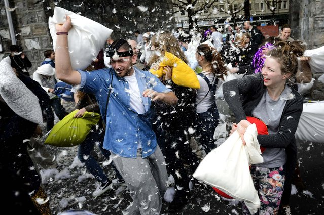 People participate in a pillow fight to mark International Pillow Fight Day in Lausanne, Switzerland. (Photo by Laurent Gillieron/Keystone)