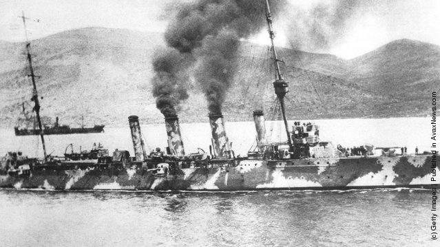 A Royal Navy cruiser painted in dazzle camouflage in the Dardanelles, 1915