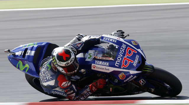 Yamaha's Jorge Lorenzo steers his bike during the third free practice for the motorcycle GP in Montmelo, Spain, Saturday, June 13, 2015. The Catalunya Grand Prix will take place on Sunday in Montmelo. (AP Photo/Manu Fernandez)