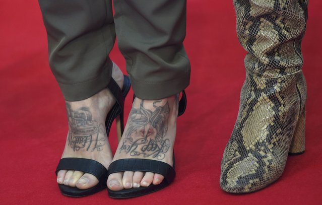 """A guest sporting tattoos on her feet arrives at the European premiere of """"Captain America, Civil War"""" at a shopping centre in east London, Britain April 26, 2016. (Photo by Toby Melville/Reuters)"""
