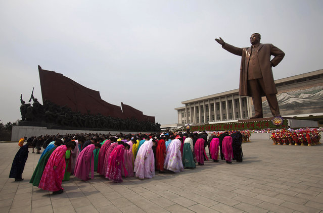 North Koreans pay their respects before a monument of Kim Il Sung at Mansu Hill in Pyongyang, North Korea, Thursday April 14, 2011. (Photo by David Guttenfelder/AP Photo)