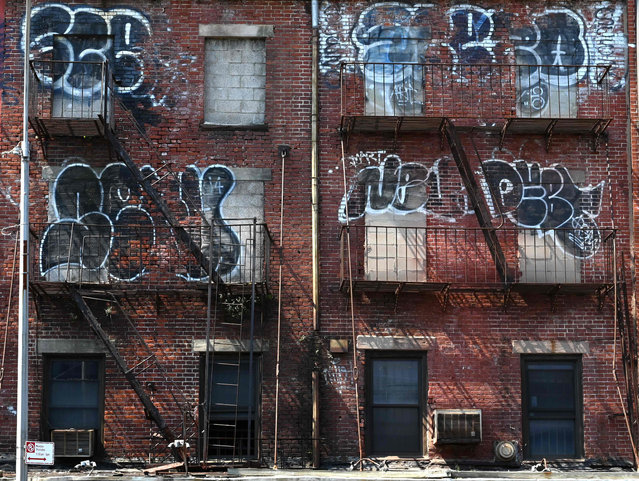 A grafitti covered building is seen in the South Street Seaport in Lower Manhattan in New York on August 15, 2019. (Photo by Timothy A Clary/AFP Photo)