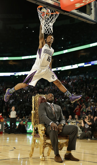 Ben McLemore of the Sacramento Kings dunks the ball as he flies over former NBA player Shaquille O'Neal during the skills competition at the NBA All Star basketball game, Saturday, February 15, 2014, in New Orleans. (Photo by Gerald Herbert/AP Photo)