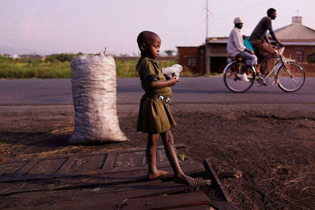 A child stands along the roadside on June 27, 2015 in Bujumbura, Burundi. Burundi is one of the worlds poorest countries with food shortages throughout the cities and countryside. The head of Burundi's influential rights group Aprodeh says at least 70 people, mostly civilians, have been killed and hundreds of others wounded following weeks of political unrest in the small and landlocked country in the African Great Lakes region of East Africa. (Photo by Spencer Platt/Getty Images)