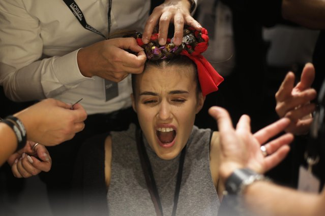 A model gets her hairdressing for the fashion show of designer Rebekka Ruetz Spring/Summer 2016 fashion collection during the Mercedes-Benz Fashion Week in Berlin, Wednesday, July 8, 2015. (Photo by Markus Schreiber/AP Photo)