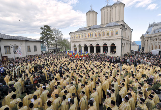 In this Saturday, April 8, 2017, picture Romanian Orthodox priests attend a service ahead of Palm Sunday in Bucharest, Romania. (Photo by Vadim Ghirda/AP Photo)