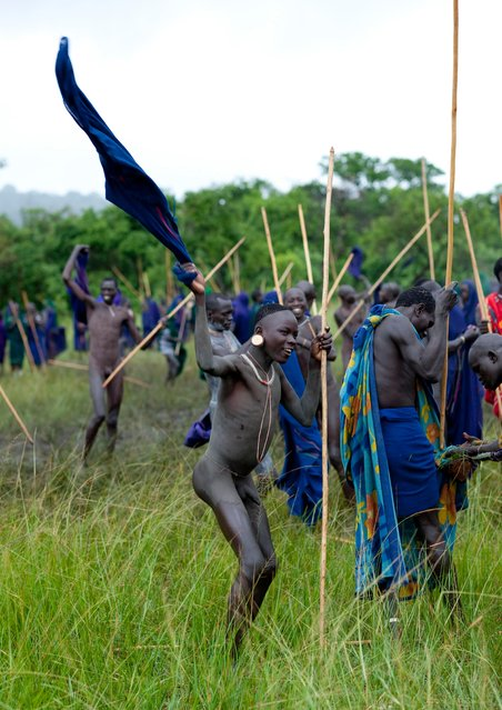 Most of the warriors use no protection at all and fight completely naked in order to show their bravery. (Photo by Eric Lafforgue/Exclusivepix Media)