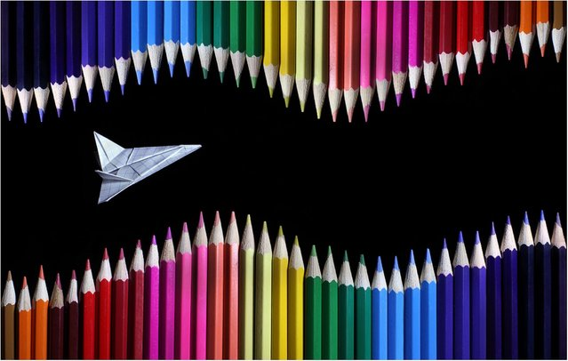 """Colored Pencil and Origami Landscapes: """"A graph paper plane navigates its way through waves of pencils"""". (Photo by Victoria Ivanova)"""