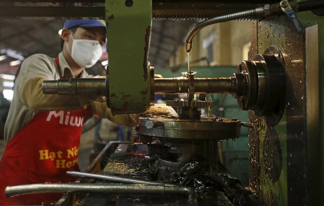 A man works at a factory which produces agro-machines, in Ha Dong, outside Hanoi, Vietnam July 13, 2015. Vietnam's economic growth could rise to 6.5 percent in 2015, beyond the 6.2 percent target, thanks to a solid manufacturing sector, the Finance Ministry said late last month, citing a government think tank. (Photo by Reuters/Kham)